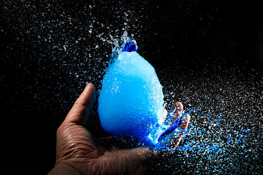 The moment the blue water and water balloon exploded
