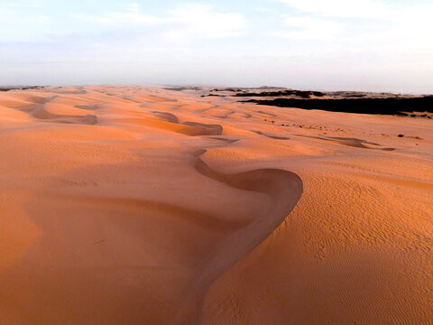 View of sand dunes during sunset