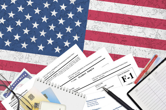 USCIS form I-20 Certificate of eligibility for nonimmigrant student status lies on flat lay office table and ready to fill. U.S. Citizenship and Immigration services paperwork concept
