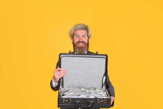 Business. Smiling businessman hold case with money. Dirty money. Businessman with case. Bribe and money laundering. Business man with suitcase full of money.