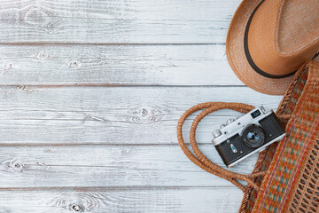 Lay flat white wooden background, vintage summer accessories, vintage film camera, save memories of summer.