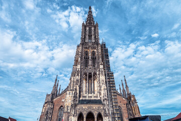 Fototapete - Ulm Minster or Cathedral of Ulm city, Germany. It is top landmark of Ulm. Front view of famous medieval Christian church of Ulm