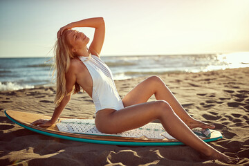 Sexy woman at swimsuit on the beach.Surfer girl.