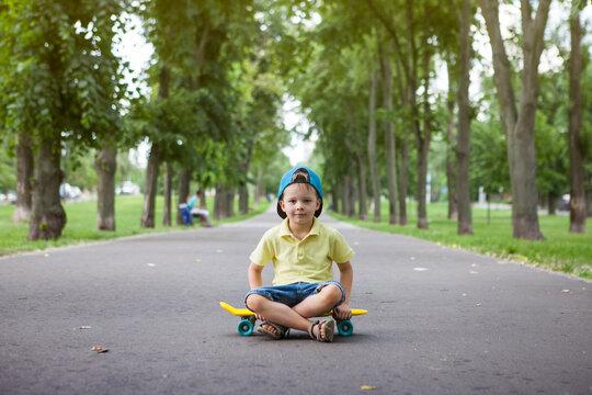 Little boy on skate board.