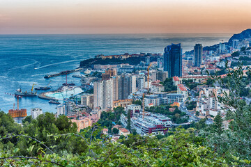 Panoramic view of Monaco at sunset from the Grande Corniche