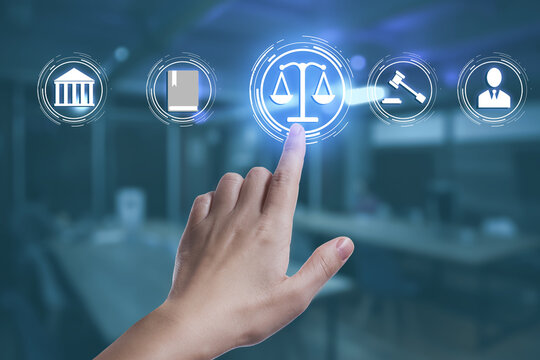 Laws, legal information and online consultation. Woman using virtual screen with icons, closeup