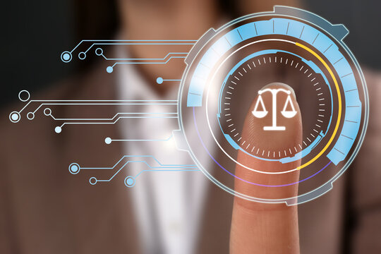 Lawyer touching virtual screen with scales icon, closeup