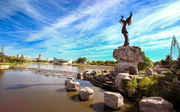 Keeper of the plains Sculpture in dramatic background in Wichita Kansas