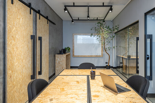 interior design of a office with notebook osb table and sliding doors