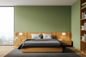 Green master bedroom interior with bookcase