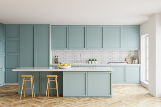 White and blue kitchen interior with bar