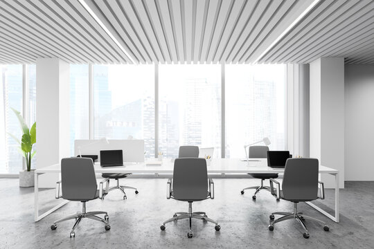 Workplace in white panoramic open space office