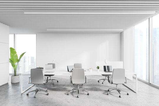 Workplace in white loft office