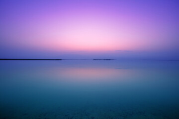 Fototapete - Dead Sea in the early morning. Wild nature. Tropical minimalist landscape. Sunrise over the sea. Summertime