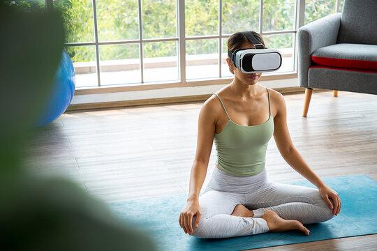 Healthy asian woman relaxing zen with virtual reality sitting on matt