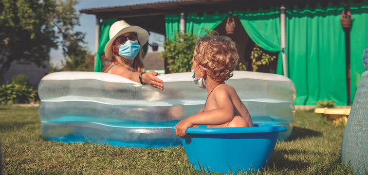 Staycation,Travel, relax at home in the pool. Social distance, remote work. Stay at home, quarantine, lockdown,covid 19.Family resting at home on the lawn in the pools,local travel