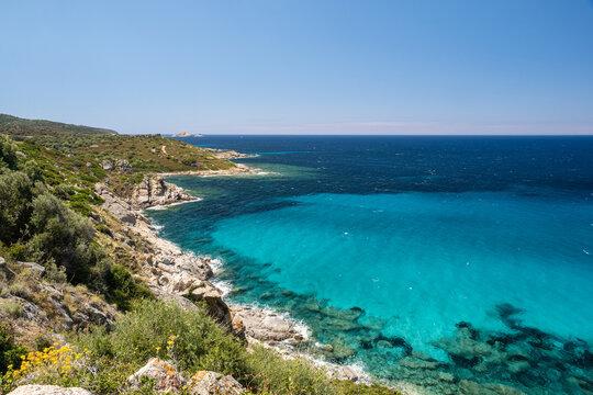 Turquoise sea and rugged coast of Corsica