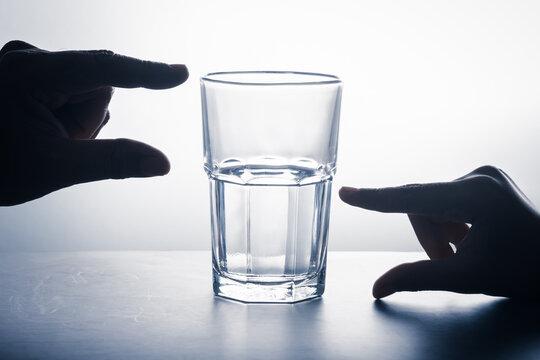 Hands on Glass Half Full