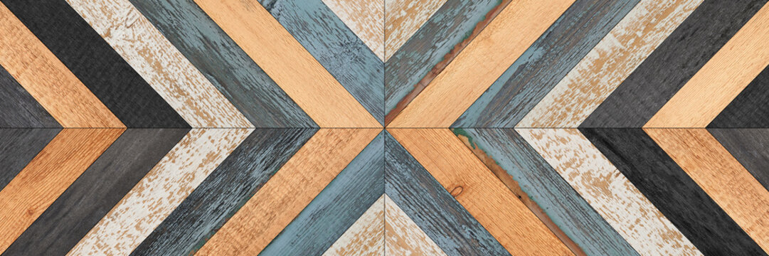 Weathered wooden boards texture. Shabby wooden wall with chevron pattern.