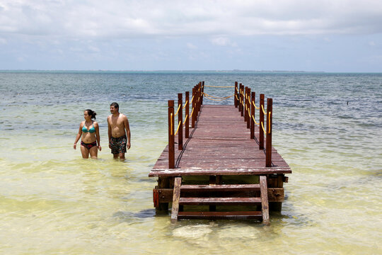 Tourists stand at a beach after local authorities imposed strict sanitary measures to gradually reopen despite the coronavirus disease (COVID-19) pandemic, in Cancun