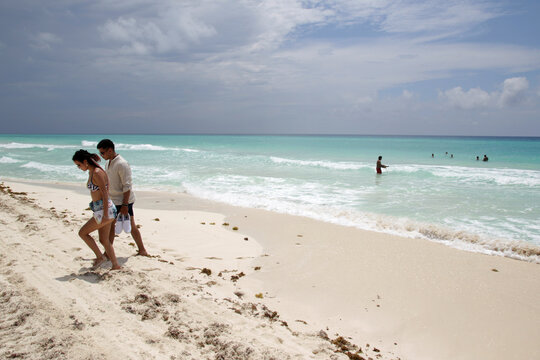 Tourists are seen at a beach after local authorities imposed strict sanitary measures to gradually reopen despite the coronavirus disease (COVID-19) pandemic, in Cancun