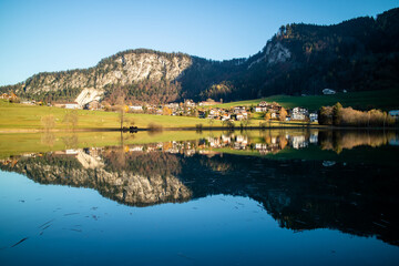 Wall Mural - Beautiful landscape with country area near the lake and reflection in it.