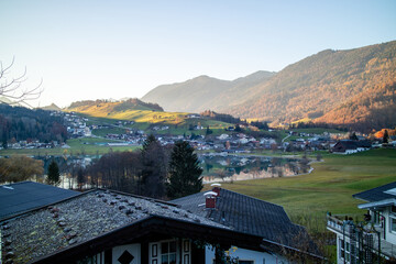 Wall Mural - Traditional rural landscape with houses, fields and mountains in Austria.