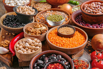 Different raw legumes with spices on table Papier Peint