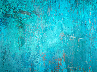 Old crackled teal turquoise painted wood surface. Vintage wooden wall or floor with cracked paint.