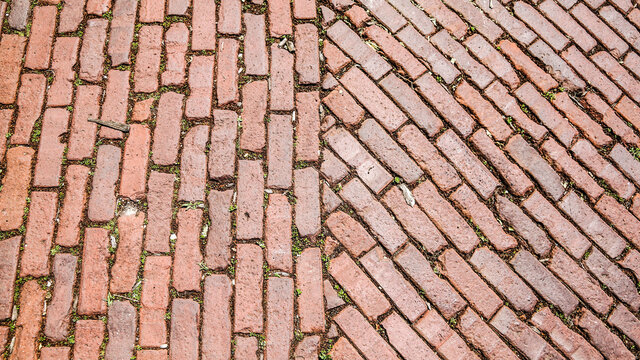 Old brickwork on a street in an old town area. Abstract brick background