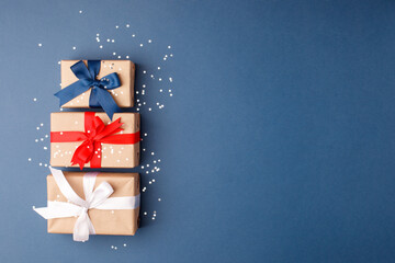 Red, blue and white gift boxes on classic blue background in the national colors of America,...