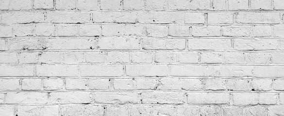 White brick wall. Facade of an old building. Architectural background.