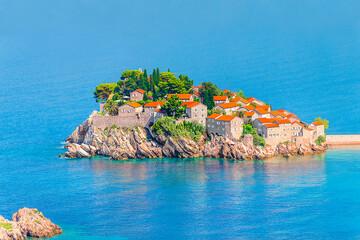 Sveti Stefan airview, island and hotel resort in Montenegro, southeast of Budva. Balkans, Adriatic sea, Europe. Travel destinations background.