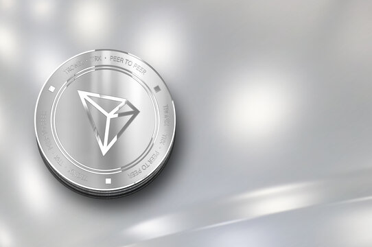 Tronix (TRX) digital crypto currency. Silver coin. Cyber money.