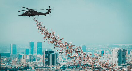 Photo sur Toile Inde helicopter that distributes euro money over the city.