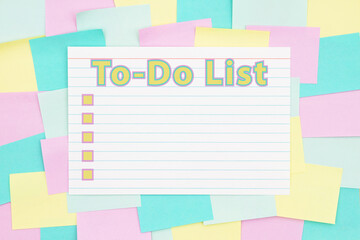 To-Do List type with checkboxes on a sticky note background with multi-color notes
