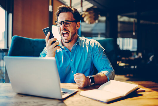 Dissatisfied businessman is angry during telephone conversation