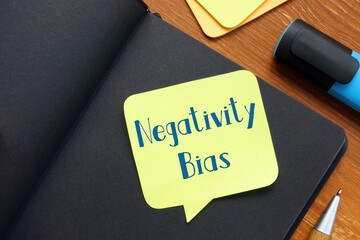 Motivation concept about Negativity Bias with inscription on the page.