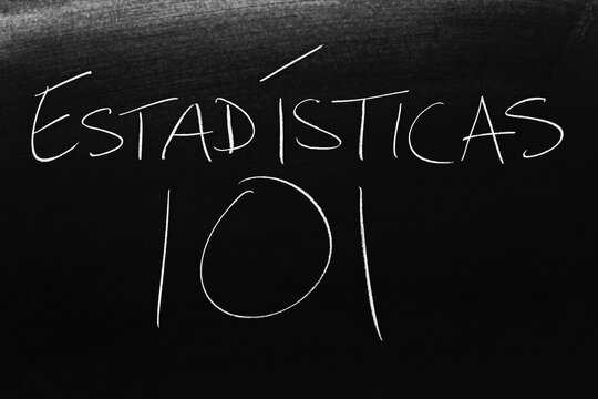 The words Estadísticas 101 on a blackboard in chalk.  Translation: Statistics 101