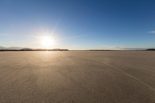 Afternoon sun at El Mirage dry lake bed in Mojave desert area of Southern California.