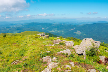 Wall Mural - mountain summer landscape. meadow with stones in the grass on top of the hillside near the summit