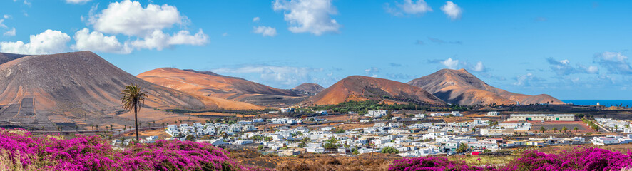 Wall Mural - Landscape with small village on Lanzarote island in Timanfaya national park, Canary islands, Spain.