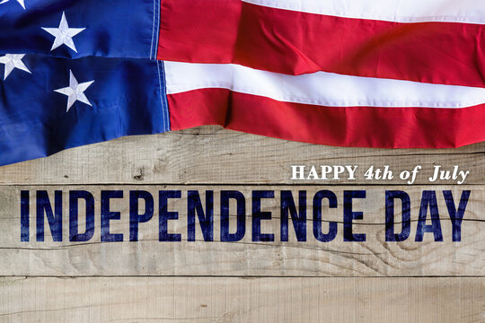 American flag on wooden background. Independence day national holiday greeting card