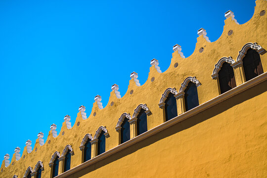 Diagonal detail of a yellow colonial building in Merida, Yucatán, Mexico