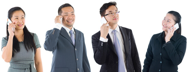 Group of Asian business people using smartphone