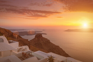 Wall Murals Santorini Sunset overlooking the caldera and the sea in the village of Imerovigli on the island of Santorini in the summer. Greece. White roof on a foreground.