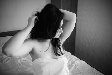 Body positive concept, young plus size arabic appearance woman, vintage black & white photo