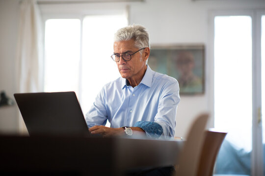 businessman working from home with laptop computer