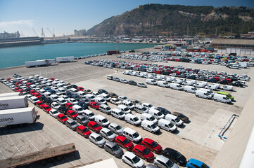 Barcelona, Spain - March 30, 2016: new cars on parking in sea port. Auto export and car import. Vehicles shipment. Car trade commerce. Shipping activity. Car exhibition for sale