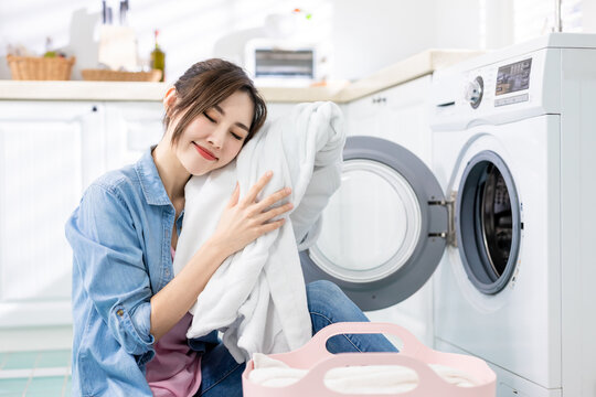 Asian housewife wash clothes